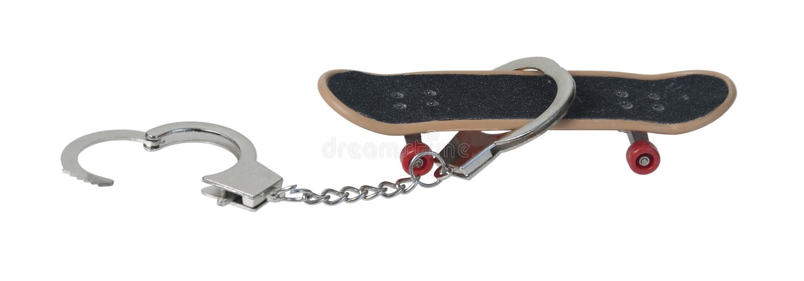 Skateboard with Handcuffs stock images