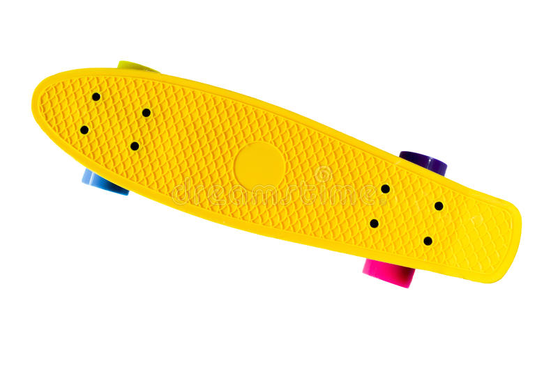 Skateboard isolated on white. Yellow skate board with colourful wheels isolated on white background royalty free stock photos