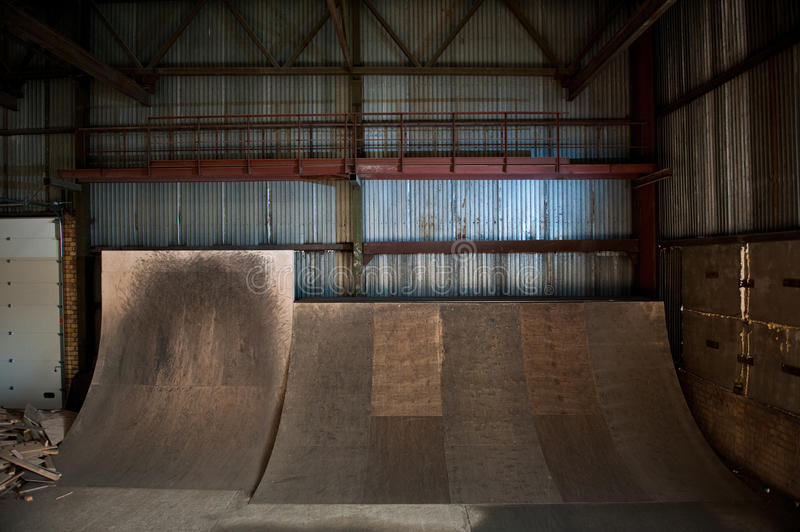 Skateboard ramps. Wooden skateboard ramps in warehouse royalty free stock photography