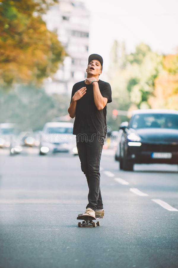 The skateboard rider on the street exhausted of riding skate stock images