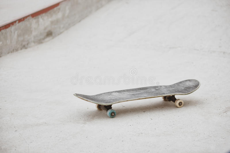 Skateboard at skatepark ready for riding on grey concrete background royalty free stock photo