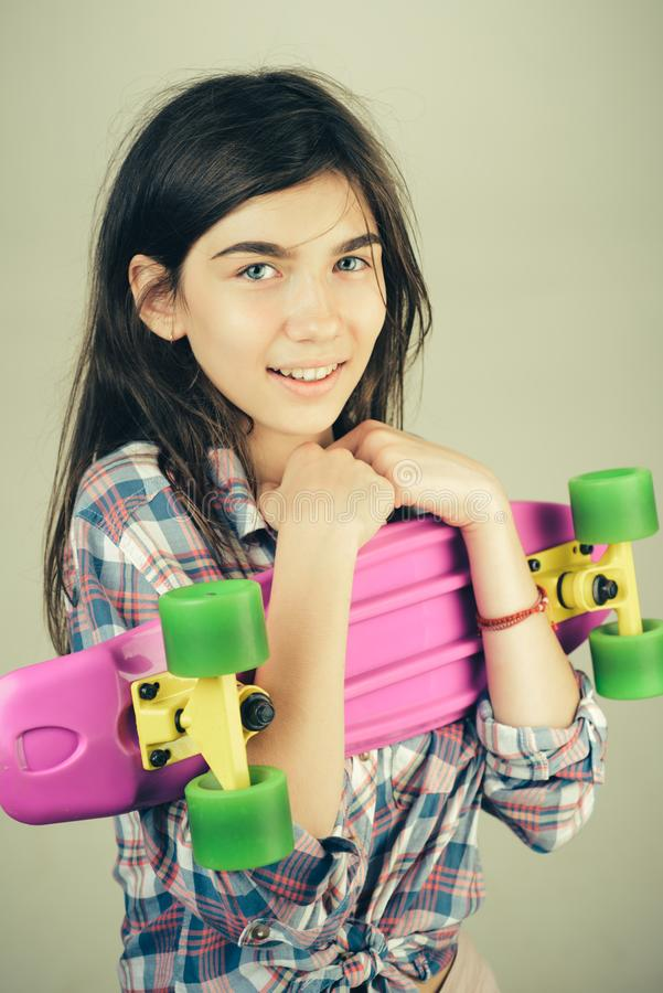Skateboard sport hobby. Summer activity. Hipster girl with penny board. Urban scene, city life. plastic mini cruiser. Board. Spring. ready to ride on the street royalty free stock images