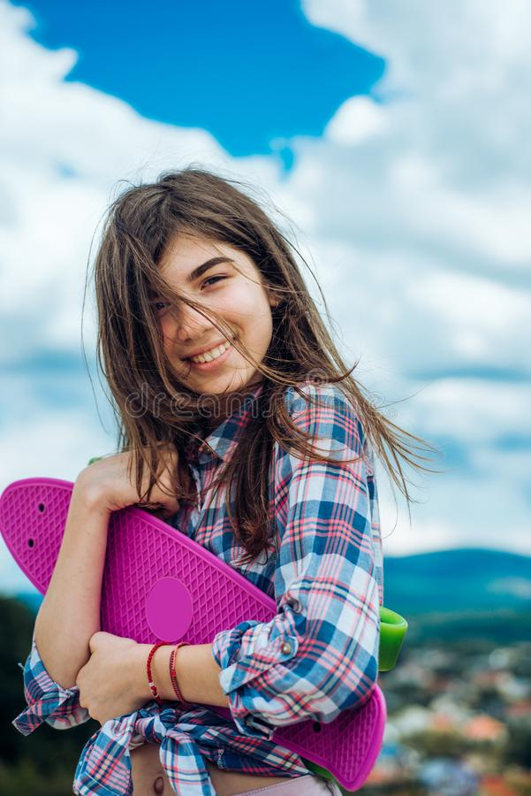 Skateboard sport hobby. Summer activity. Hipster girl with penny board. Urban scene, city life. plastic mini cruiser. Board. Spring. ready to ride on the street stock photos