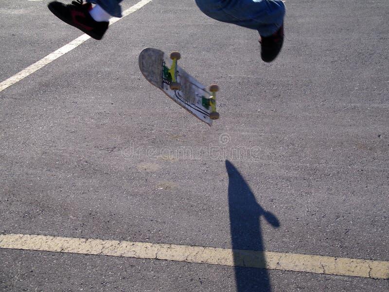 Skateboard trick with a shadow