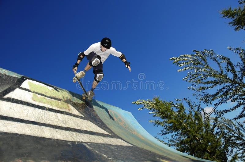 Skateboarder. A skateboarder into ramp royalty free stock photos