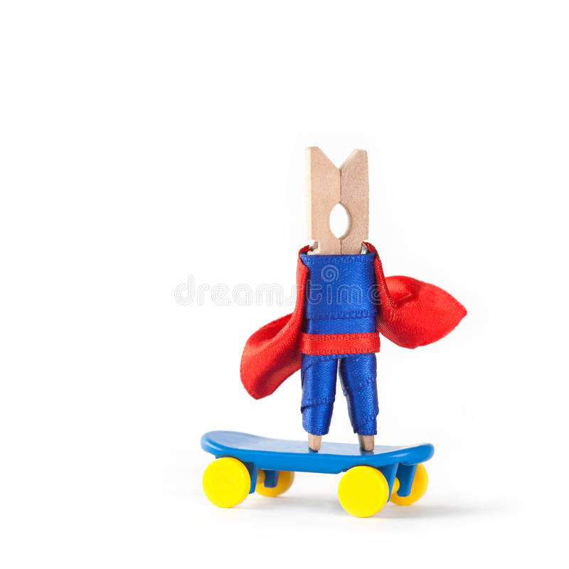 Skateboarder coach hero. Skating clothespin superhero. Sport design concept. white background, copy space royalty free stock image