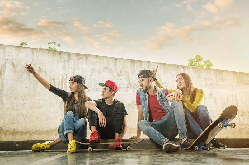 Skateboarder Couples made selfi photo.  royalty free stock photography