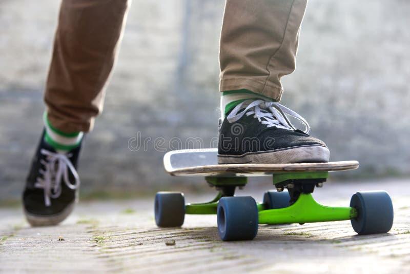 Skateboarder departing stock image