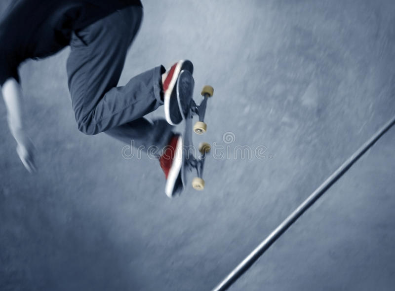 Skateboarder doing a trick stock photography