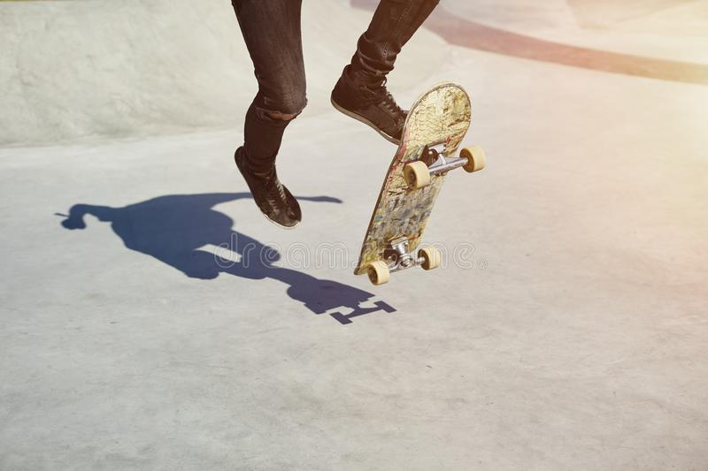 Skateboarder doing a trick in a skate park, practice freestyle extreme sport. royalty free stock image