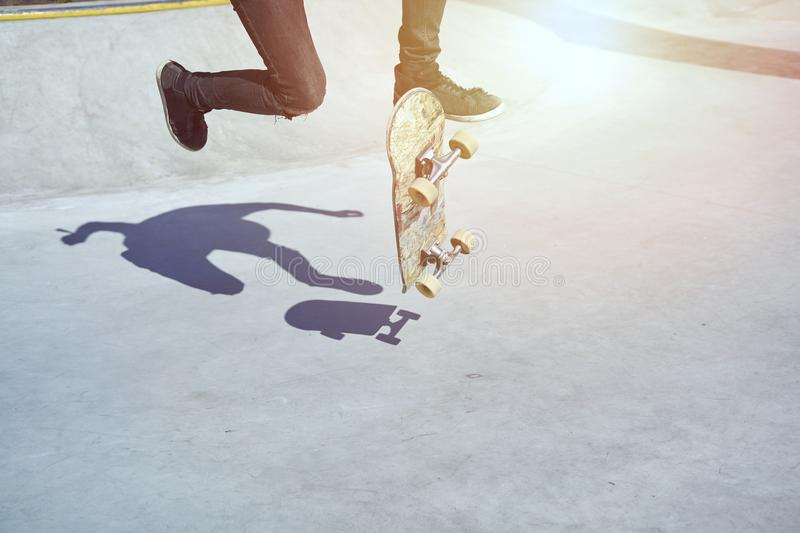 Skateboarder doing a trick in a skate park, practice freestyle extreme sport. stock photography