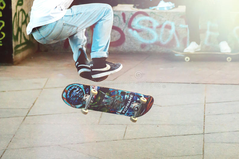 Skateboarder doing tricks royalty free stock images