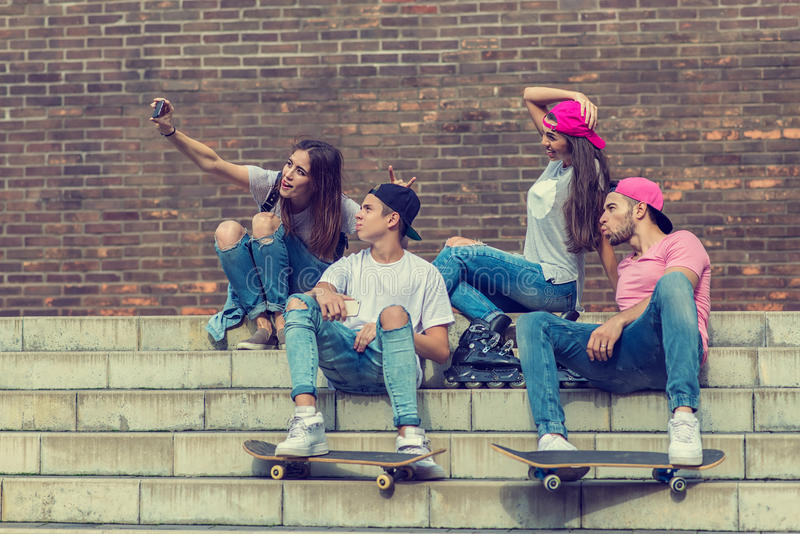 Skateboarder friends on the stairs, made selfie photo.  royalty free stock photos