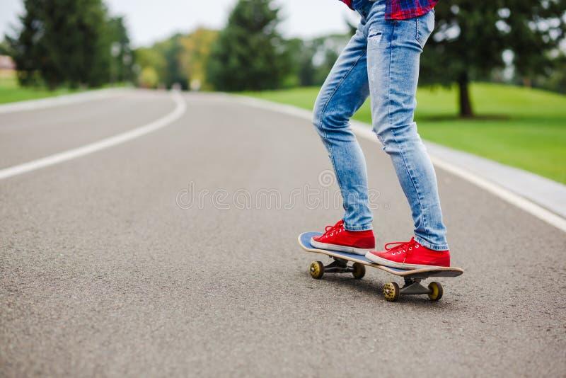 skateboarder girl with skateboard outdoor stock photography