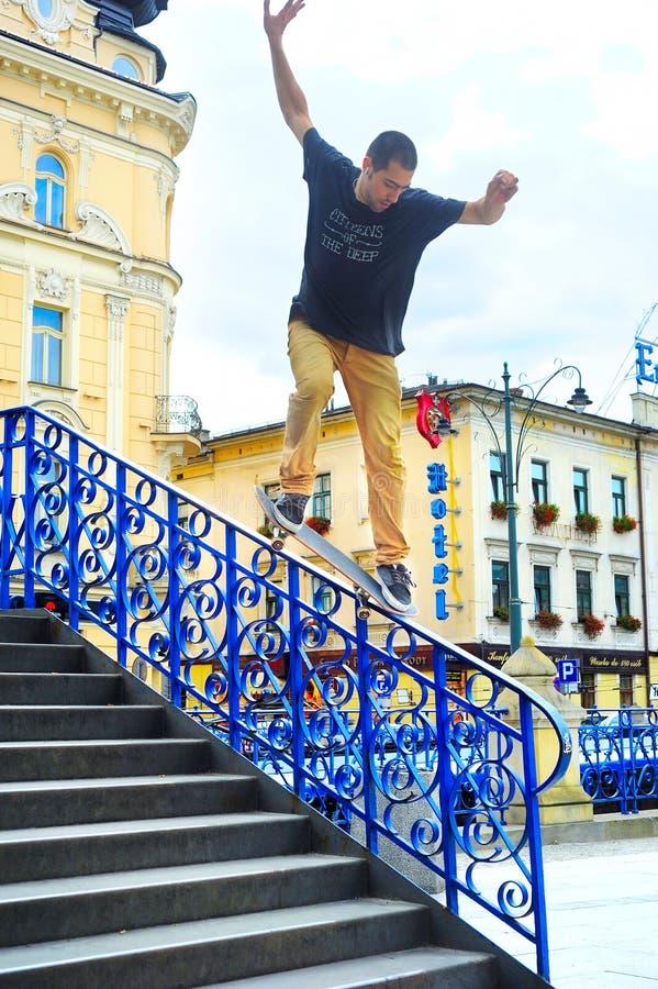 Skateboarder jumps stock photo