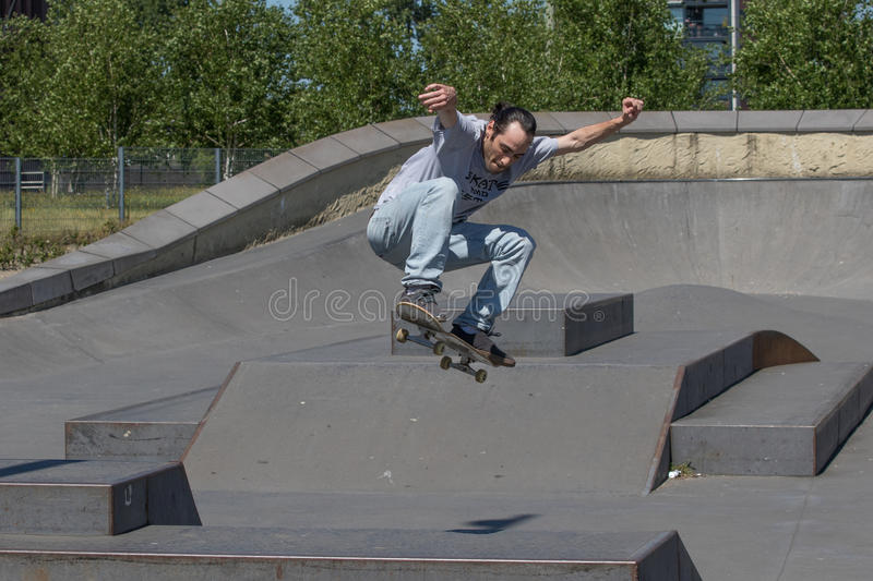Skateboarder in mid air action royalty free stock photos