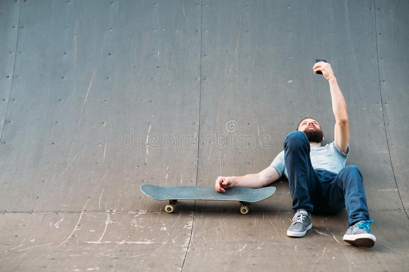 Skateboarder relaxation youth hipster ramp selfie royalty free stock photography