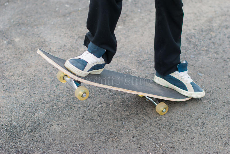 Skateboarder rides on the pavement. stock photography