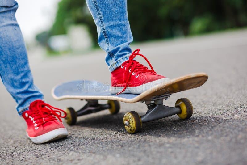 Skateboarder riding skateboard through the street royalty free stock photo