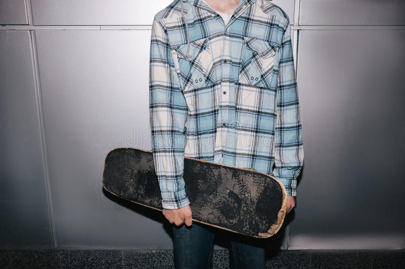 Skateboarder with skateboard. Street style stock images