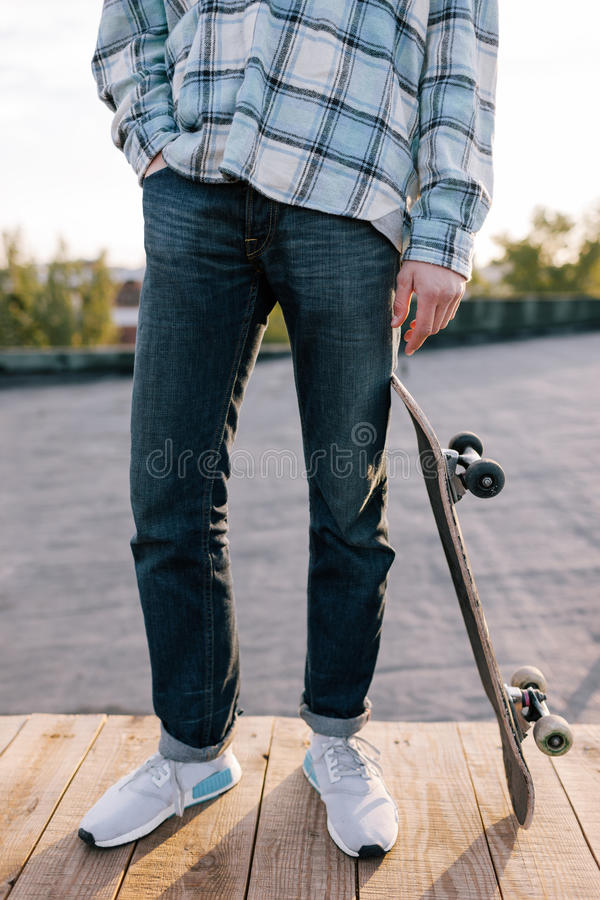 Skateboarder with skateboard. Street subculture royalty free stock photos
