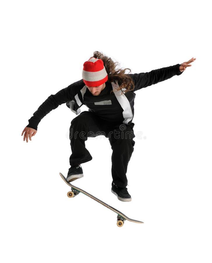 SkateboarderJumping stock foto's