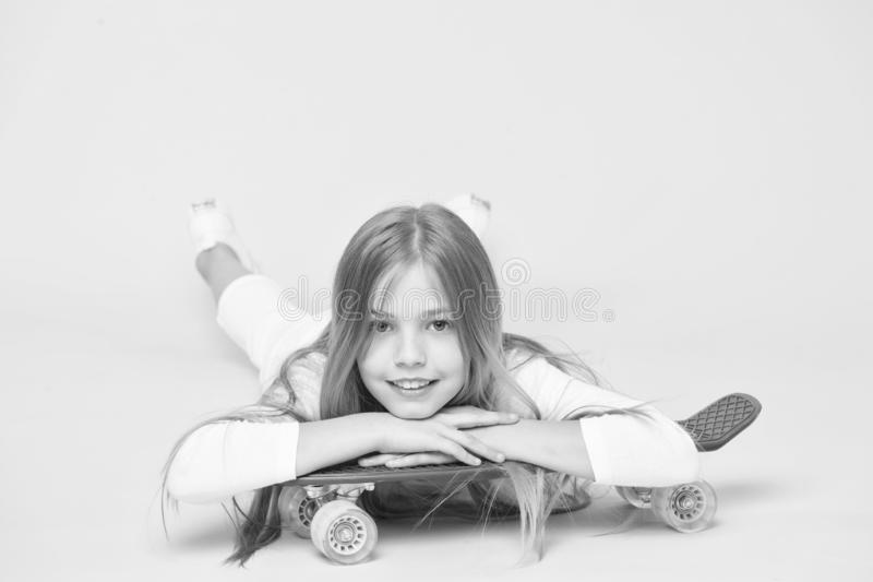 Skateboarding created the hipster. Adorable small skater smiling with hipster style and look. Cute little hipster royalty free stock photos