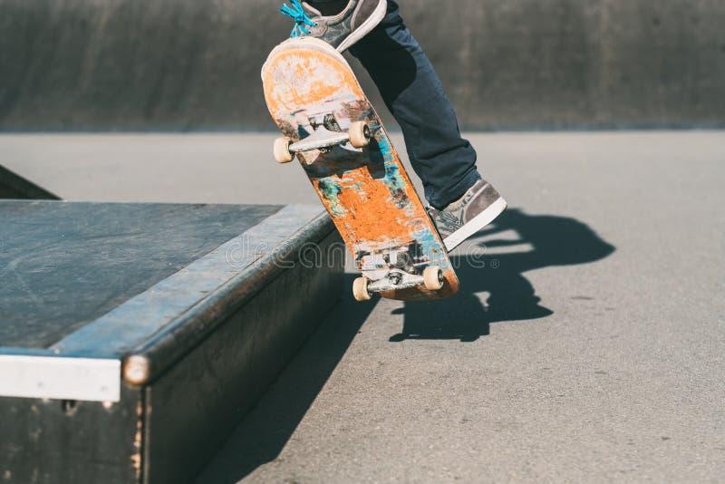 Skateboarding man feet sport trick skate park royalty free stock photo
