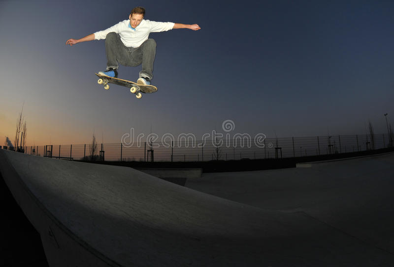 Skateboarding at night stock photo