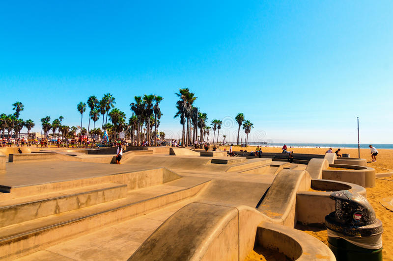 Skatepark at world famous Venice Beach. The Skate Board Park with its concrete ramps and palm trees is very famous and popular. stock photography