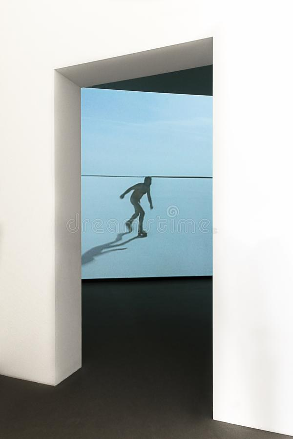 The skater of the blue lake. Abstract performance seen at the Louis Vuitton space in Paris