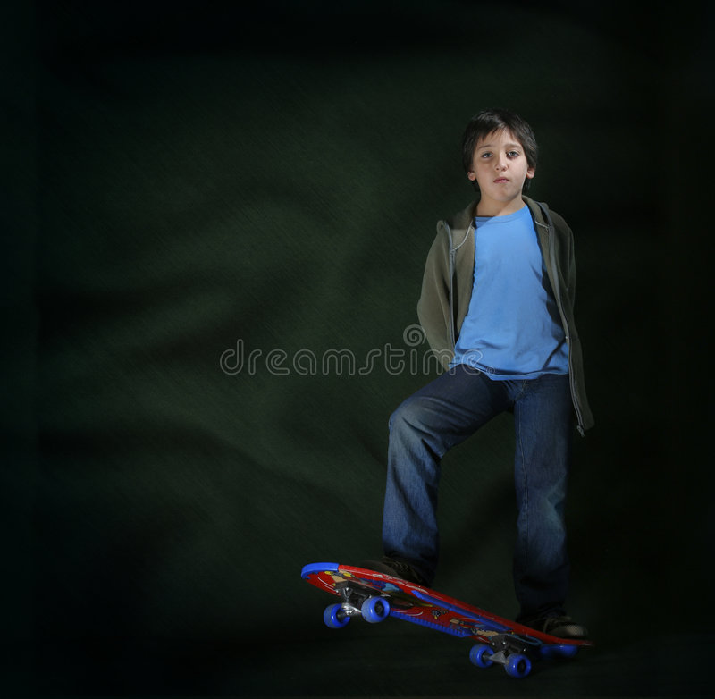 Skater boy with a cool attitude. Grunge style. Cool skater boy. Grunge style. Look at my gallery for more pictures of this models royalty free stock image