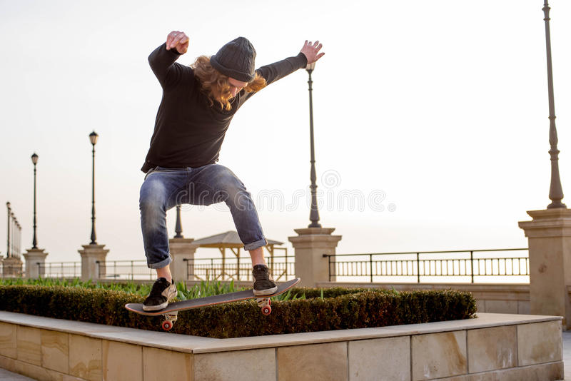 Skater boy skating on seaside royalty free stock photography