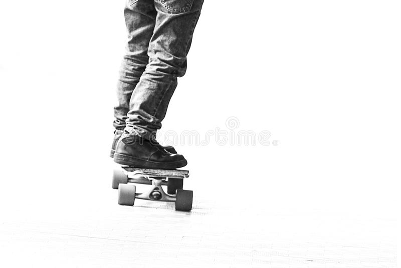 Skater boy speed with longboard royalty free stock photography