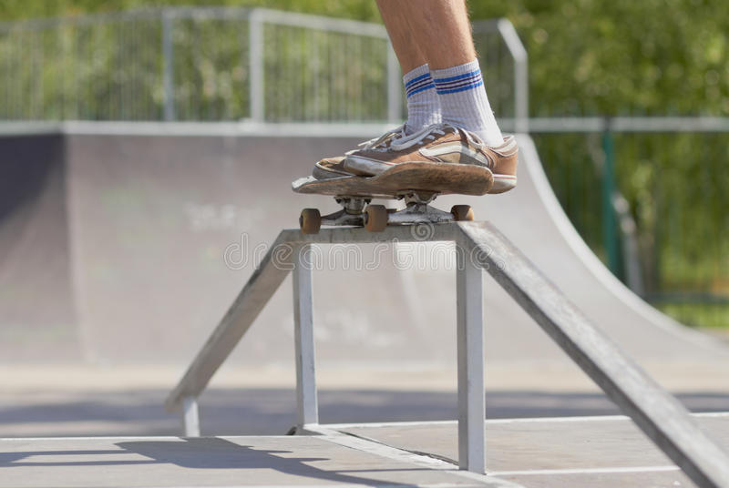 Download Skater Doing 50-50 Grind On Fun-box In Skatepark Stock Photo - Image of sport, legs: 25559080