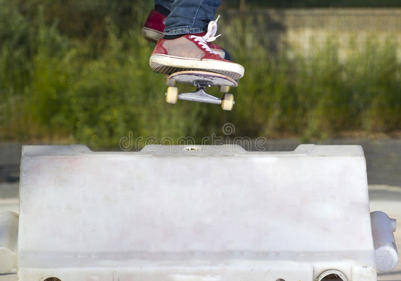 The skater jump the obstacle stock image