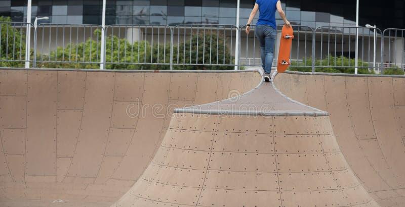 Skater legs skating on ramp stock image