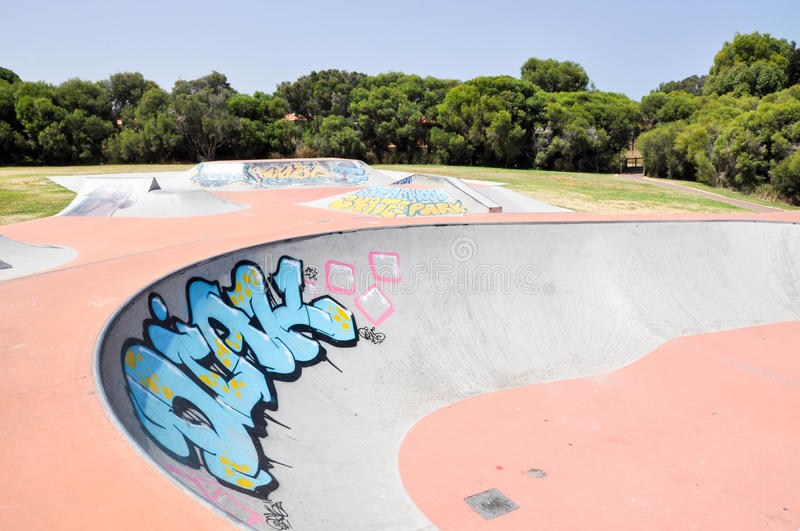 Skater Zone: Bowl and Ramps. SPEARWOOD,WA,AUSTRALIA-JANUARY 5,2016: View of skater ramps and bowl with urban art and tagging at Spearwood Skate Park in Spearwood royalty free stock photos