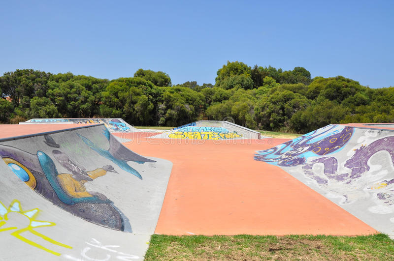 Skater Zone: Spine and Ramps. SPEARWOOD,WA,AUSTRALIA-JANUARY 5,2016: View of skate ramps with urban art and tagging at Spearwood Skate Park in Spearwood, Western royalty free stock image