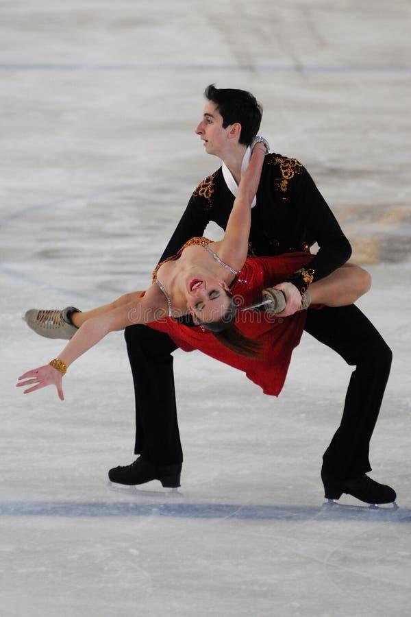 Skateres do gelo em um campeonato de 2011 italianos fotografia de stock royalty free