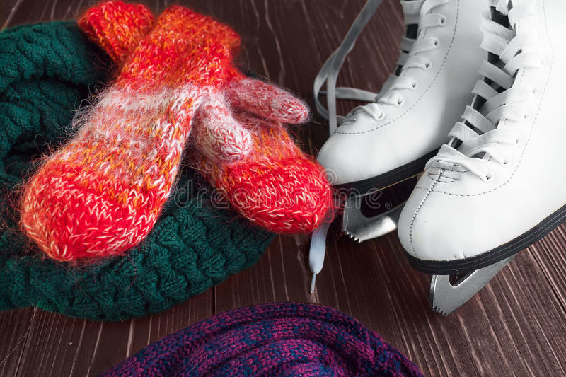 Skates for figure skating and mittens royalty free stock photos
