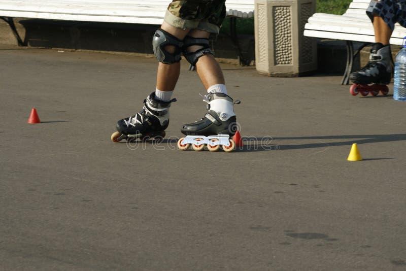 Skates in a park royalty free stock photos
