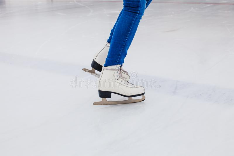 Skates on the rink. Woman on the ice stock images