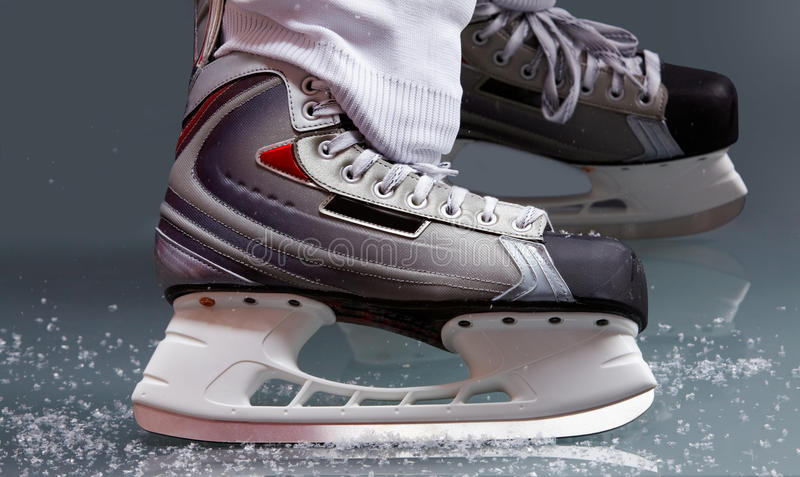 Skating. Close-up of skates on player feet during ice hockey stock images