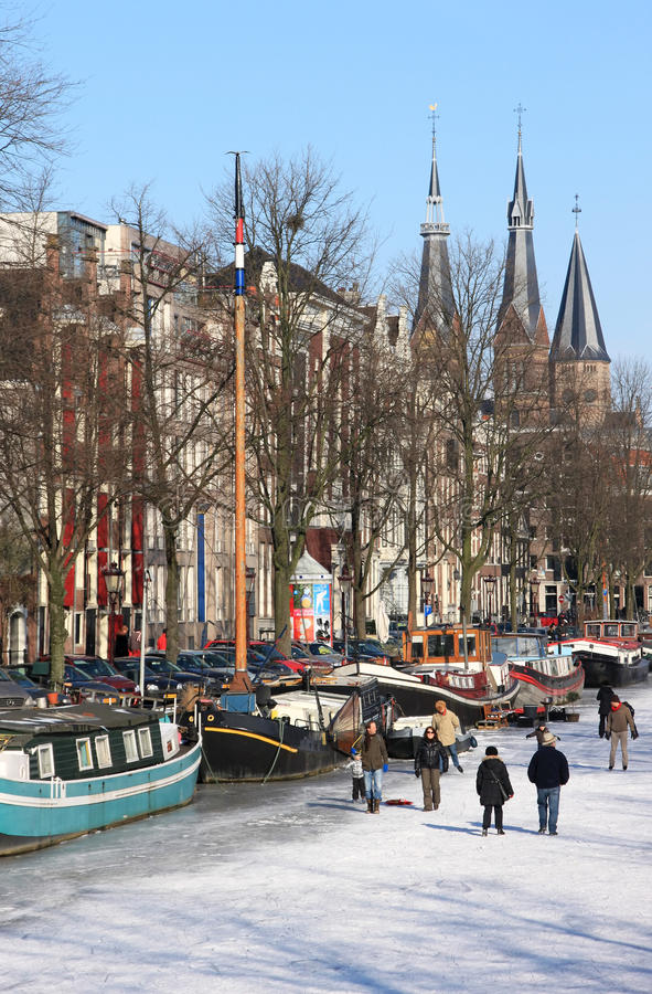 Download Skating Over The Dutch Frozen Canals, Amsterdam Editorial Stock Image - Image: 23440039