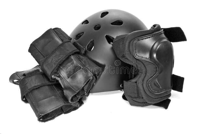 Skating protection equipment. Helmet and knee and wrist protectors, on a white background stock photos
