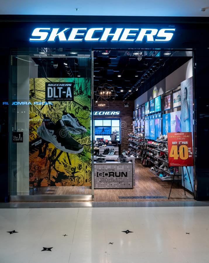 Skechers shop at Central Westgate Bangkok, Thailand, May 10, 2018. Fashionable footwear brand window display. Front view from entrance stock image