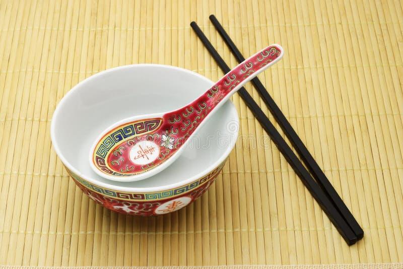 skedar kinesiska pinnar för bunke traditionellt royaltyfri fotografi