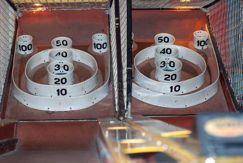 Skee ball at an amusement part. Two Skee ball machines at an amusement part stock photography