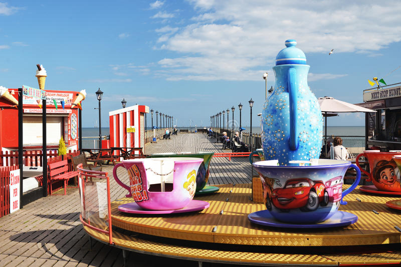 Skegness pier with fun rides Yorkshire stock photo